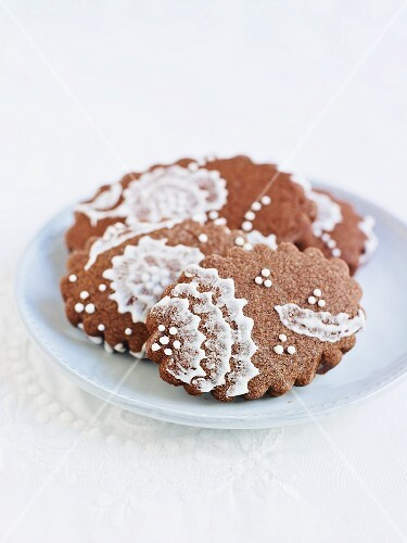 Chocolate biscuits with iced lace decoration