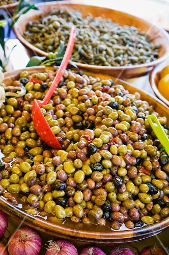 A bowl of black and green olives