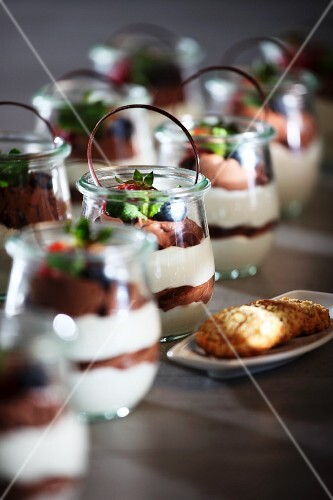 White and dark chocolate mousse in dessert glasses