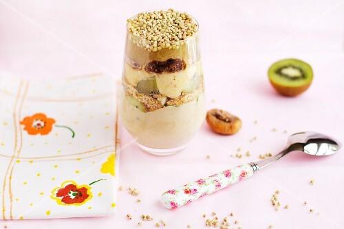 A layered dessert with buckwheat, figs, kiwi, yoghurt, vanilla tofu cream and apple sauce