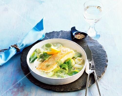 Fried cod fillet on a leek medley