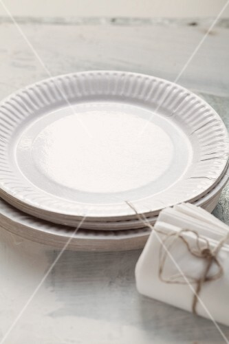 A stack of disposable paper plates