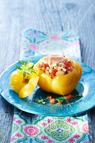 A yellow tomato with a bean and tuna filling