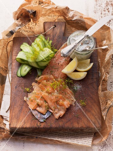 Filleted char with dill flowers, remoulade, sliced cucumber and lemon wedges