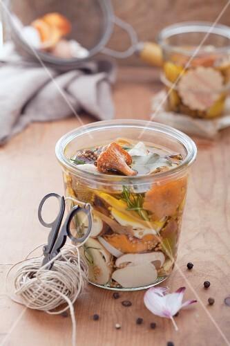 A jar of preserved wild mushrooms