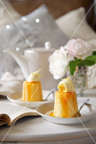 Lemon sponge pudding with vanilla ice cream (England)