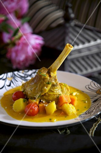Lamb shank with curried vegetables