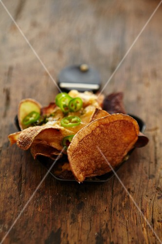 Raclette with potato crisps and chilli rings