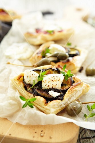 Raclette with aubergines, feta and giant capers