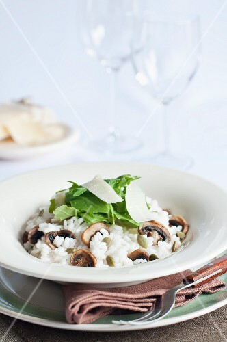 Risotto with mushrooms, pumpkin seeds, rocket and Parmesan