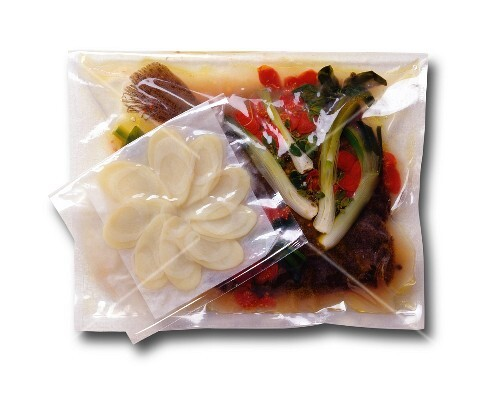 Vacuum-packed fish dish with vegetables and a side of potatoes