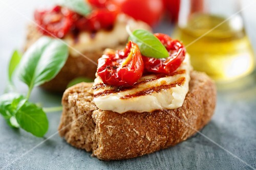 Crostini topped with grilled goat's cheese and dried tomatoes