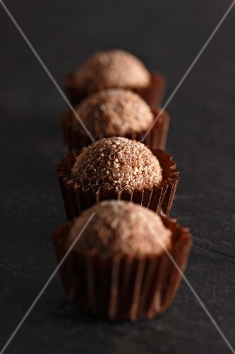 A row of noisette truffle pralines