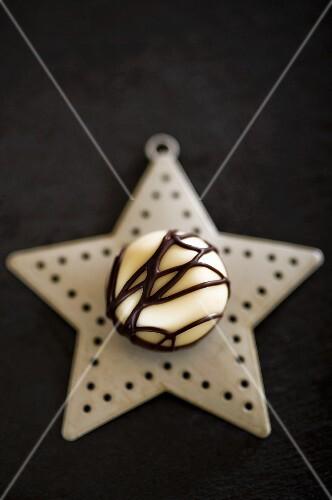 A white chocolate praline on a Christmas star