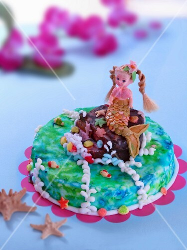 A child's cake decorated with a mermaid