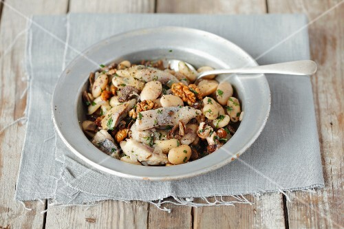 Herring salad with beans, dried mushrooms, onions and walnuts