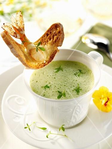 Foamed cress soup with a prawn crostini