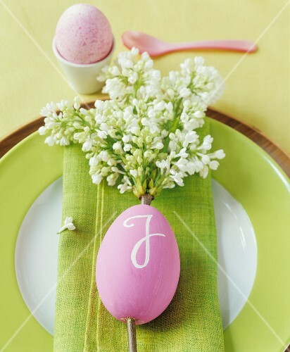 An Easter place setting decorated with white lilac