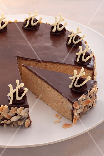 A marzipan and almond layer cake with chocolate glaze (Herrentorte)