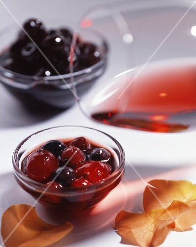 Fruits marinated in alcohol, and a glass of red wine