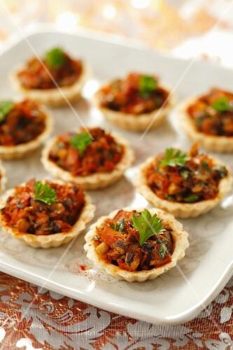 Ham and mushrooms tartlets