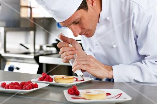 Chef decorating gourmet dessert in commercial kitchen