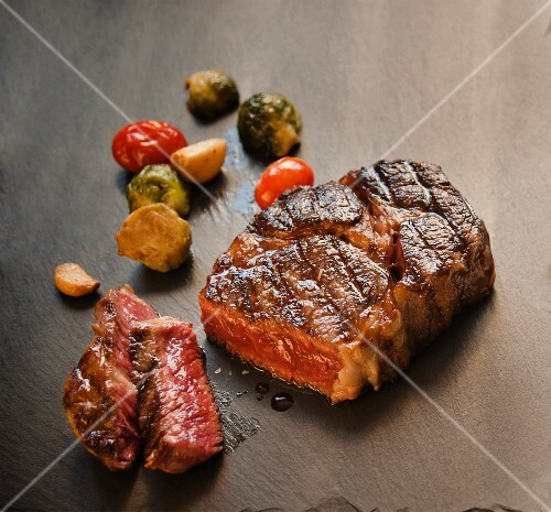 Wagyu Steak Cooked Rare; Roasted, Garlic, Brussels Sprouts and Tomatoes