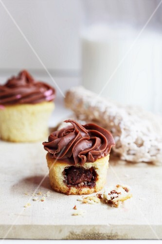 Filled cupcakes with chocolate icing