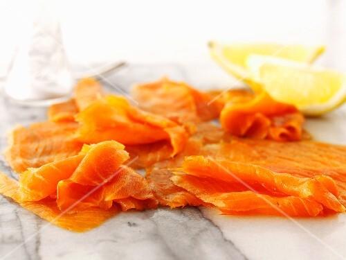 Smoked salmon and lemon wedges