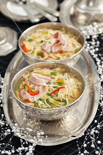 Noodle soup with bacon, spring onions and chilli