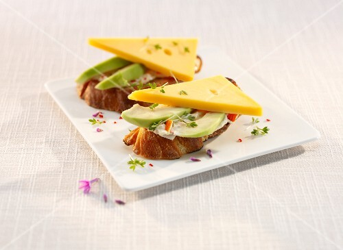 Bread topped with avocado, cheese and surimi