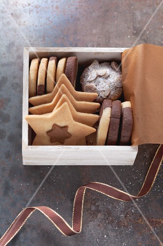 An assortment of biscuits in a small wooden box