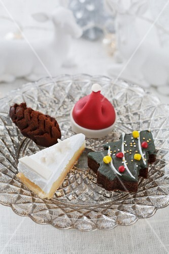 An assortment of baked Christmas goods in a crystal dish