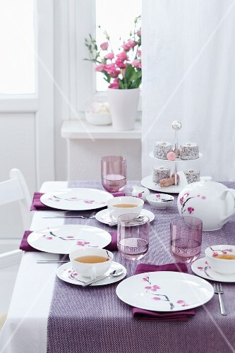 A table laid for afternoon tea, with a tiered cake stand