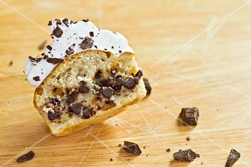 A vanilla cupcake with chocolate drops