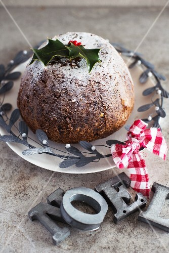Christmas pudding with icing sugar and holly