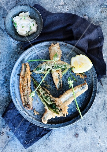 Deep-fried herring with lemon and a herb butter