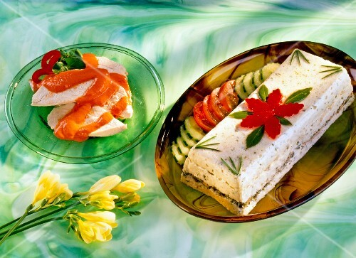 Vegetable terrine, garnished with tomatoes and cucumber