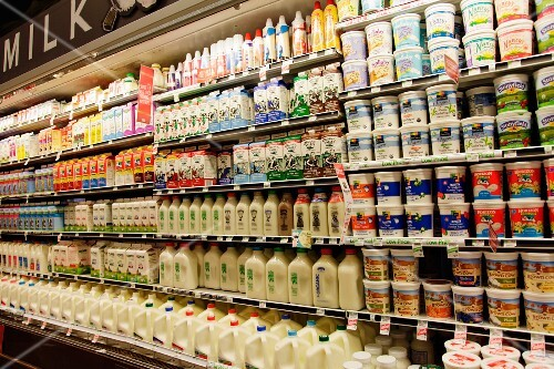 Many different dairy products in the chiller at a supermarket (USA)