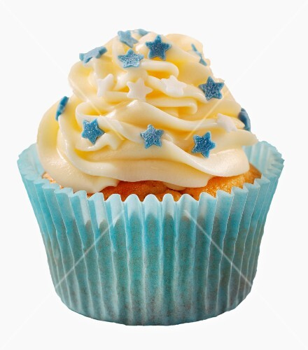 A cupcake decorated with buttercream and little stars