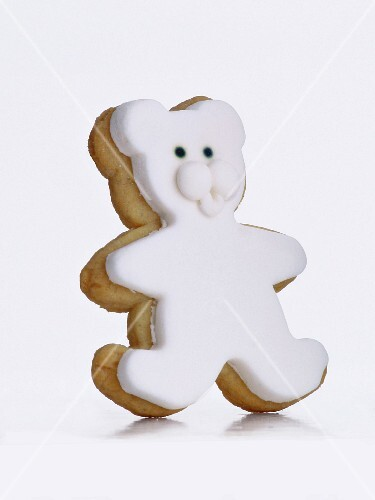 A biscuit in the shape of a bear, with white glaze