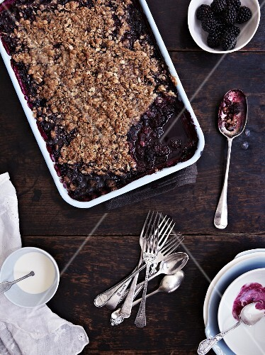 Blackberry and blueberry crumble in a baking dish
