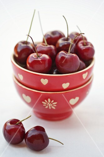 Fresh cherries in stacked bowls
