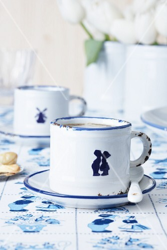 Espresso cups decorated with porcelain stickers (Dutch-style designs)