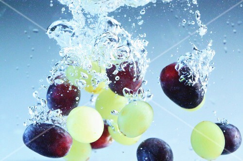 Grapes falling into water