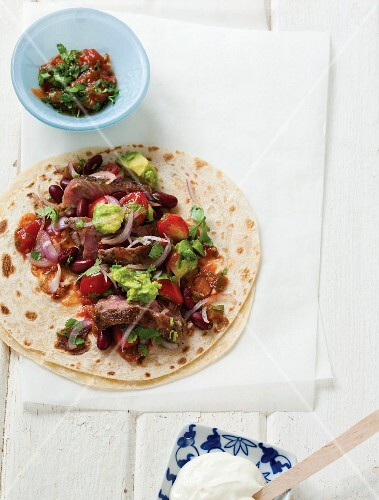 Tortilla with beef, tomatoes and avocados