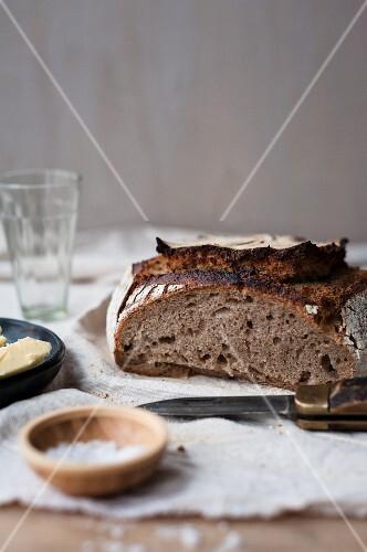 Home-made sourdough bread, salt and butter