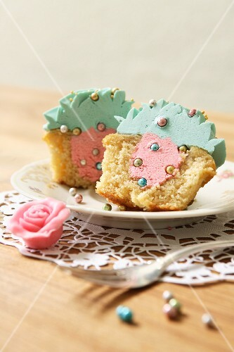 A cupcake filled with strawberry buttercream and topped with turquoise icing