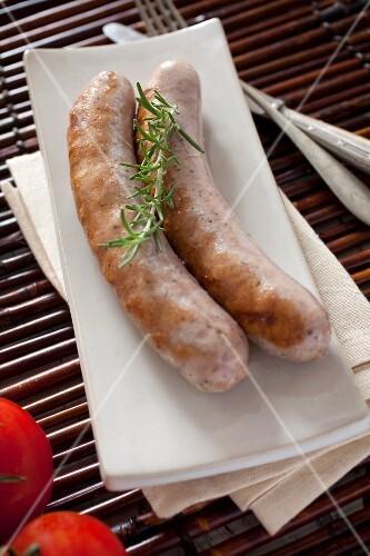 Two fried butifarra (fresh pork sausage, Catalonia)
