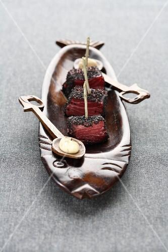 Raw tuna coated in poppy seeds